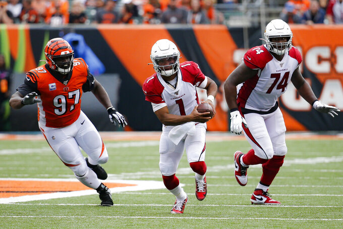 Arizona Cardinals quarterback Kyler Murray (1) runs the ball past Cincinnati Bengals defensive tackle Geno Atkins (97) in the second half of an NFL football game, Sunday, Oct. 6, 2019, in Cincinnati. (AP Photo/Frank Victores)