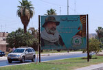 A poster of killed militia faighter with Popular Mobilization militia is seen in Baghdad, Iraq, Friday, June 26, 2020. Iraqi security forces arrested over a dozen men suspected of a spate of rocket attacks against the U.S. (AP Photo/Hadi Mizban)