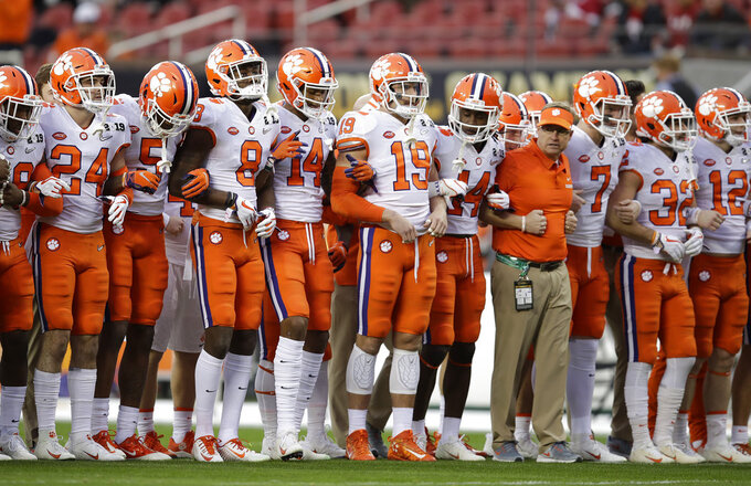 Clemson players line up before the NCAA college football playoff championship game against Alabama Monday, Jan. 7, 2019, in Santa Clara, Calif. (AP Photo/Ben Margot)