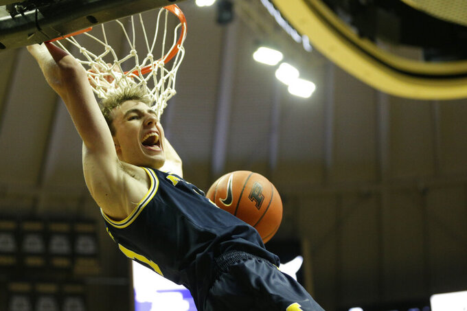 Michigan guard Franz Wagner (21) dunks during the first half of an NCAA college basketball game, Saturday, Feb. 22, 2020, in West Lafayette, Ind. (Nikos Frazier/Journal & Courier via AP)