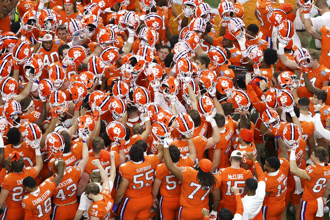 FILE - Clemson gathers before the Sugar Bowl NCAA college football game against Ohio State in New Orleans, in this Friday, Jan. 1, 2021, file photo. Clemson is No. 3  in The Associated Press Top 25 preseason college football poll released Monday, Aug. 16, 2021. (AP Photo/Butch Dill, File)
