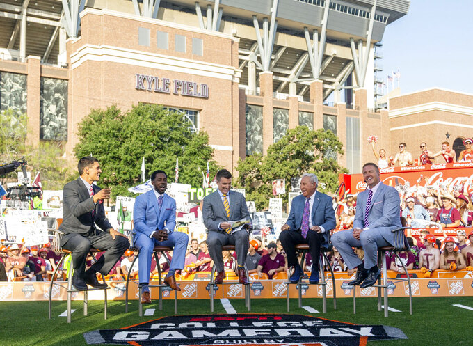 "FILE - In this Sept. 8, 2018, file photo ,ESPN College Game Day's crew sits on set in front of Kyle Field in College Station, Texas. before the start of an NCAA college football game between Clemson and Texas A&M. After 15 years of the Washington State flag begin a backdrop fixture to every ""College GameDay"" broadcast, ESPN is going to Pullman Wash., on Saturday.(AP Photo/Sam Craft, File)"
