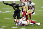 New Orleans Saints safety Chauncey Gardner-Johnson (22) celebrates his sack of San Francisco 49ers quarterback Nick Mullens (4) in the second half of an NFL football game in New Orleans, Sunday, Nov. 15, 2020. (AP Photo/Brett Duke)