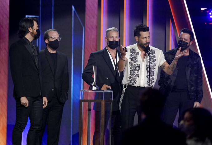 Matthew Ramsey, second from right, and members of Old Dominion, accept the award for group of the year at the 56th annual Academy of Country Music Awards on Sunday, April 18, 2021, at the Grand Ole Opry in Nashville, Tenn. (AP Photo/Mark Humphrey)