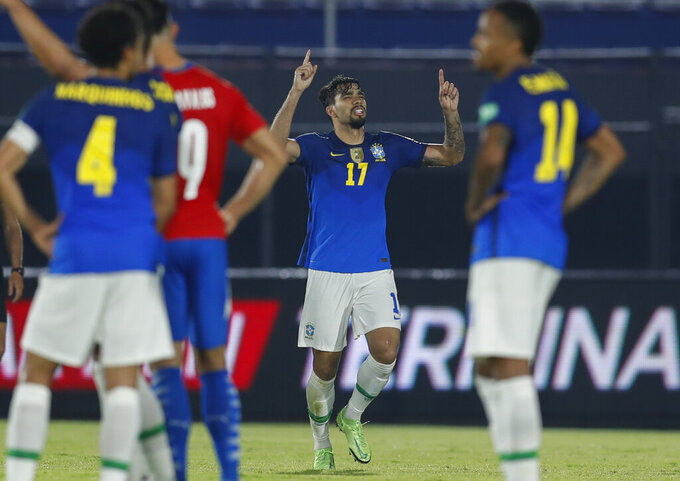 Brazil's Lucas Paqueta, center, celebrates after scoring his side's 2nd goal against Paraguay during a qualifying soccer match for the FIFA World Cup Qatar 2022 at Defensores del Chaco stadium in Asuncion, Paraguay, Tuesday, June 8, 2021. (AP Photo/Jorge Saenz)