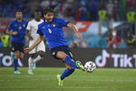 Italy's Manuel Locatelli, left, scores his side's first goal during the Euro 2020 soccer championship group A match between Italy and Switzerland at the Rome Olympic stadium, Wednesday, June 16, 2021.  (Alfredo Falcone/LaPresse via AP)
