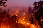 The French Fire burns hillsides along Highway 155 in Sequoia National Forest, Calif., on Wednesday, Aug. 25, 2021. (AP Photo/Noah Berger)