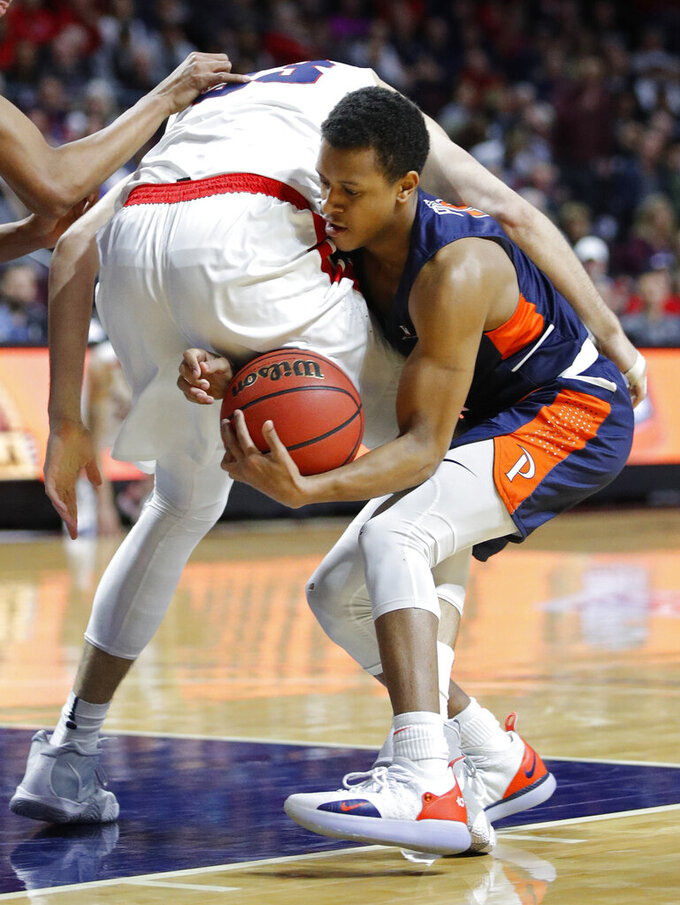 Pepperdine's Darryl Polk Jr., right, steals the ball from Gonzaga's Killian Tillie during the first half of an NCAA semifinal college basketball game at the West Coast Conference tournament, Monday, March 11, 2019, in Las Vegas. (AP Photo/John Locher)