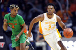 Tennessee guard Josiah-Jordan James (5) drives the ball up court past Florida A&M guard MJ Randolph (3) during the second half of an NCAA college basketball game Wednesday, Dec. 4, 2019, in Knoxville, Tenn. Tennessee won 72-43. (AP Photo/Wade Payne)
