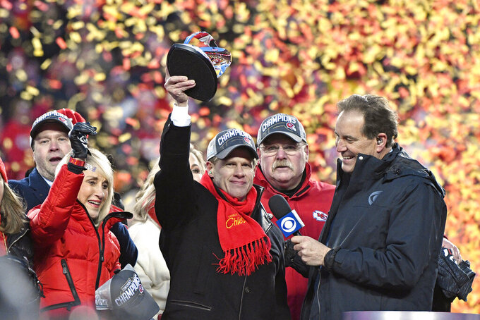 FILE - In this Sunday, Jan. 19, 2020, file photo, Norma Hunt, left, and her son Clark Hunt, center, owners of the Kansas City Chiefs, and Chiefs head coach Andy Reid, second right, celebrate after the AFC Championship NFL football game against the Tennessee Titans in Kansas City, Mo. Passing the family business onto the kids is a delicate chore, even when the whole world isn't watching. When it plays out in the NFL, everyone gets to see the successes and failures unveiled in real time. Clark Hunt of the Chiefs took over the team when his trailblazing father, Lamar, died in 2006. (AP Photo/Jeff Roberson, File)