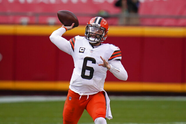 Cleveland Browns quarterback Baker Mayfield (6) throws a pass during the first half of an NFL divisional round football game against the Kansas City Chiefs, Sunday, Jan. 17, 2021, in Kansas City. (AP Photo/Jeff Roberson)