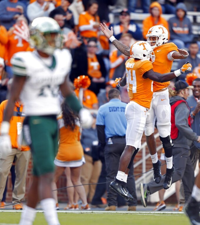 Tennessee bowl hopes alive with 14-3 win over Charlotte