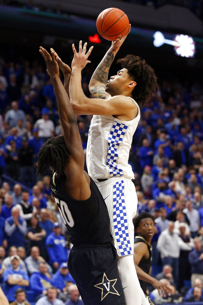 Kentucky's Nick Richards, right, shoots while pressured by Vanderbilt's Ejike Obinna during the second half of an NCAA college basketball game in Lexington, Ky., Wednesday, Jan 29, 2020. (AP Photo/James Crisp)