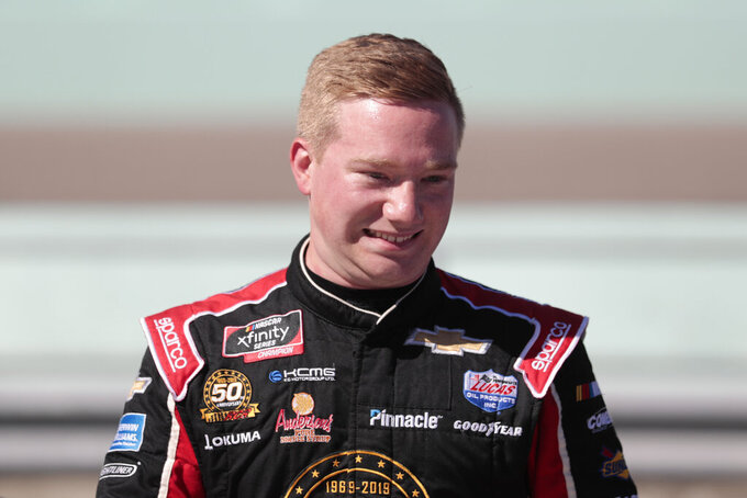 Tyler Reddick poses is seen in the pits after winning the pole position for the NASCAR Xfinity Series auto racing championship at Homestead-Miami Speedway in Homestead, Fla. Saturday, Nov. 16, 2019. (AP Photo/Luis M. Alvarez)