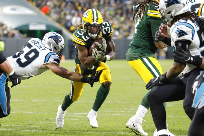 Green Bay Packers' Aaron Jones runs for a touchdown during the first half of an NFL football game against the Carolina Panthers Sunday, Nov. 10, 2019, in Green Bay, Wis. (AP Photo/Mike Roemer)