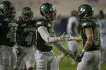 Eastern Michigan defensive back Blake Bogan (23) high fives wide receiver Mathew Sexton (87) after Sexton blocked a punt during the Camellia Bowl  NCAA college football game  in Montgomery, Ala., on Saturday, Dec. 15, 2018. (Jake Crandall/The Montgomery Advertiser via AP)