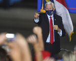 Vice President Mike Pence acknowledges the crowd at the beginning of a campaign event at an airport in Wilmington, N.C., Tuesday, Oct. 27, 2020. (Matt Born/The Star-News via AP)