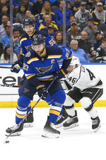 St. Louis Blues' Alex Pietrangelo (27) handles the puck in front of Los Angeles Kings' Blake Lizotte (46) and Blues' Colton Parayko (55) during the second period of an NHL hockey game Thursday Oct. 24, 2019, in St. Louis. (AP Photo/Scott Kane)