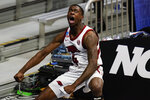Arkansas guard Davonte Davis (4) reacts after a dunk against Texas Tech in the second half of a second-round game in the NCAA men's college basketball tournament at Hinkle Fieldhouse in Indianapolis, Sunday, March 21, 2021. (AP Photo/Michael Conroy)
