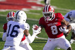 Indiana running back Stevie Scott III (8) runs against Penn State's Ji'Ayir Brown (16) during the first half of an NCCAA college football game, Saturday, Oct. 24, 2020, in Bloomington, Ind. (AP Photo/Darron Cummings)