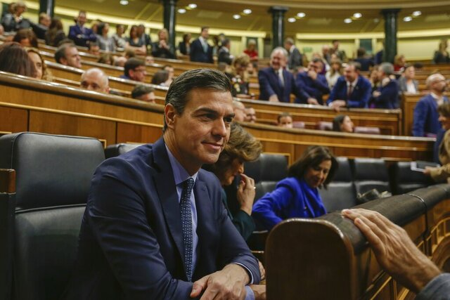 Spain's Caretaker Prime Minister Pedro Sanchez smiles, during the opening of the Spanish parliament in Madrid, Tuesday, Dec. 3, 2019. Deputies elected in Spain's November elections, the fourth in as many years, took their seats in the national parliament Tuesday but there is still no clear sign that a government can be formed soon and fresh elections avoided. (AP Photo/Paul White)