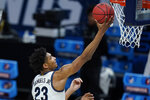 Villanova's Jermaine Samuels (23) puts up a shot during the first half of a second-round game against North Texas in the NCAA men's college basketball tournament at Bankers Life Fieldhouse, Sunday, March 21, 2021, in Indianapolis. (AP Photo/Darron Cummings)