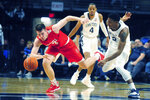 FILE - Cornell's Jimmy Boeheim, left, and Penn State's Izaiah Brockington (12) go after a loose ball during second half action of an NCAA college basketball game in State College, Pa., in this Sunday, Dec. 29, 2019, file photo. Jimmy Boeheim is transferring to Syracuse to play for his father and with his younger brother after three seasons at Cornell. Coach Jim Boeheim's oldest son made the announcement Friday, April 16, 2021, on Instagram. (AP Photo/Gary M. Baranec, File)