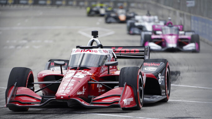 Santino Ferrucci (45) races during the first race of the IndyCar Detroit Grand Prix auto racing doubleheader on Belle Isle in Detroit Saturday, June 12, 2021. (AP Photo/Paul Sancya)
