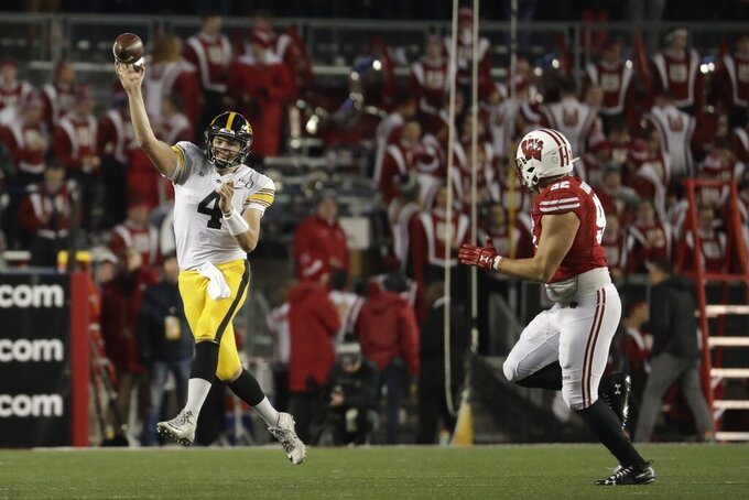 Taylor's big day helps No. 16 Badgers edge No. 18 Iowa 24-22