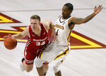 Wisconsin guard Brad Davison (34) drives on Minnesota guard Dupree McBrayer (1) during the first half of an NCAA college basketball game Wednesday, Feb. 6, 2019, in Minneapolis. (AP Photo/Andy Clayton-King)