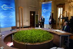 President Joe Biden speaks to the virtual Leaders Summit on Climate, from the East Room of the White House, Friday, April 23, 2021, in Washington, as Special Presidential Envoy for Climate John Kerry, looks on.