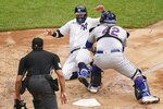 New York Yankees' Clint Frazier (77) is tagged out at home by New York Mets catcher Wilson Ramos, right, in the fourth inning of a baseball game, Saturday, Aug. 29, 2020, in New York. (AP Photo/John Minchillo)