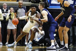 Purdue forward Trevion Williams (50) drives on Penn State forward John Harrar (21) during the first half of an NCAA college basketball game in West Lafayette, Ind., Tuesday, Feb. 11, 2020. (AP Photo/Michael Conroy)