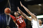 Alabama guard John Petty Jr. (23) shoots against Vanderbilt forward Dylan Disu (1) in the second half of an NCAA college basketball game Wednesday, Jan. 22, 2020, in Nashville, Tenn. Alabama won 77-62. (AP Photo/Mark Humphrey)