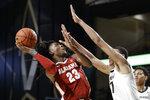 Alabama guard John Petty Jr. (23) shoots against Vanderbilt forward Dylan Disu (1) in the second half of an NCAA college basketball game Wednesday, Jan. 22, 2020, in Nashville, Tenn. Alabama won 77-62. (AP Photo/Mark Humphrey)