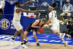 Georgia's Jaxon Etter, center, is trapped between Missouri's Jeremiah Tilmon (23) and Drew Buggs (2) in the second half of an NCAA college basketball game in the Southeastern Conference Tournament Thursday, March 11, 2021, in Nashville, Tenn. (AP Photo/Mark Humphrey)