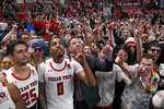 Texas Tech fans celebrate with the team after an NCAA college basketball game against TCU, Monday, Feb. 10, 2020, in Lubbock, Texas. (AP Photo/Brad Tollefson)
