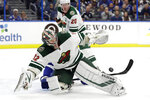 Minnesota Wild goaltender Alex Stalock (32) makes a save on a shot by the Tampa Bay Lightning during the second period of an NHL hockey game Thursday, Dec. 5, 2019, in Tampa, Fla. (AP Photo/Chris O'Meara)