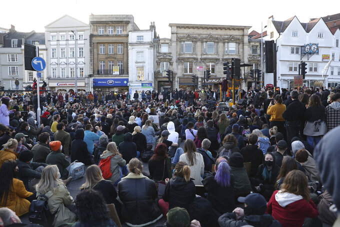 Demonstrators attend a 'Kill the Bill' protest in Bristol, England, Saturday, April 3, 2021. The demonstration is against the contentious Police, Crime, Sentencing and Courts Bill, which is currently going through Parliament and would give police stronger powers to restrict protests. (Andrew Matthews/PA via AP)