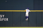 Texas Rangers center fielder Leody Taveras (3) watches as Chicago White Sox's Yasmani Grandal's home run sails over the outfield wall during the sixth inning of a baseball game, Saturday, Sept. 18, 2021, in Arlington, Texas. (AP Photo/Brandon Wade)