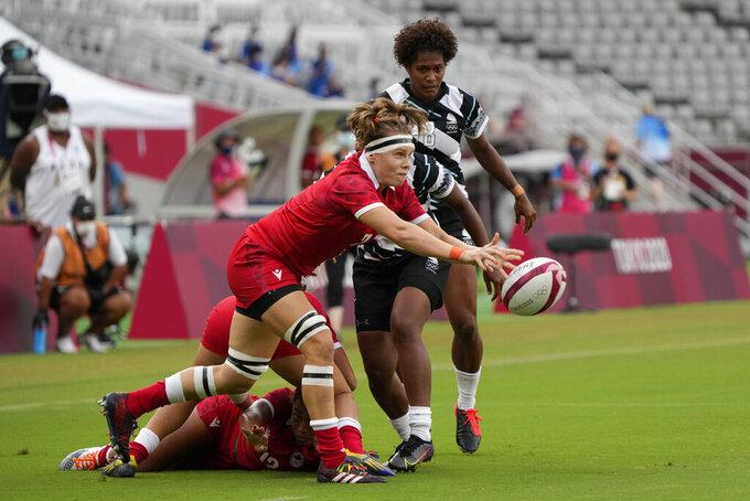 Canada's Karen Paquin passes the ball in Canada's women's rugby sevens match against Fiji at the 2020 Summer Olympics, Thursday, July 29, 2021 in Tokyo, Japan. (AP Photo/Shuji Kajiyama)