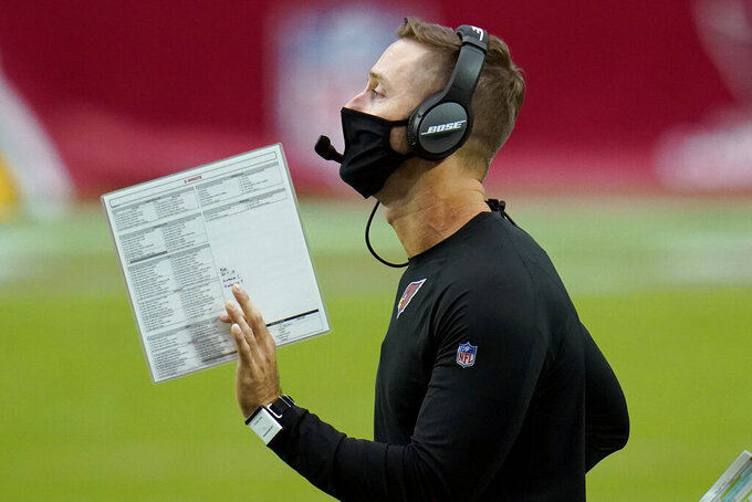 Arizona Cardinals head coach Kliff Kingsbury makes a call during the second half of an NFL football game against the Washington Football Team, Sunday, Sept. 20, 2020, in Glendale, Ariz. (AP Photo/Ross D. Franklin)