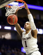 Texas A&M guard Savion Flagg dunks the ball against Vanderbilt in the second half of an NCAA college basketball game at the Southeastern Conference tournament, Wednesday, March 13, 2019, in Nashville, Tenn. Texas A&M won 69-52. (AP Photo/Mark Humphrey)