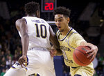 Georgia Tech's Michael Devoe (0) moves by Notre Dame's T.J. Gibbs Jr. (10) during the first half of an NCAA college basketball game Sunday, Feb. 10, 2019, in South Bend, Ind. (AP Photo/Robert Franklin)
