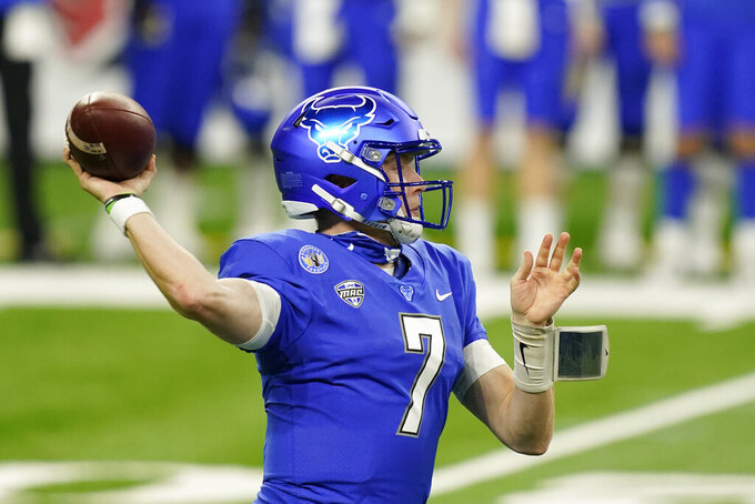 Buffalo quarterback Kyle Vantrease throws during the first half of the Mid-American Conference championship NCAA college football game against Ball State, Friday, Dec. 18, 2020, in Detroit. (AP Photo/Carlos Osorio)