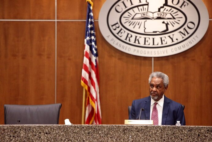 File-This Oct. 17, 2016, file photo shows Berkeley Mayor Theodore Hoskins listening during a City Council meeting in Berkeley, Mo. The 81-year-old mayor of  the St. Louis suburb was charged Thursday, Nov. 21, 2019,  with submitting fraudulent absentee voter applications in what prosecutors say was an effort to illegally influence the city's municipal elections. (Cristina M. Fletes,/St. Louis Post-Dispatch via AP)