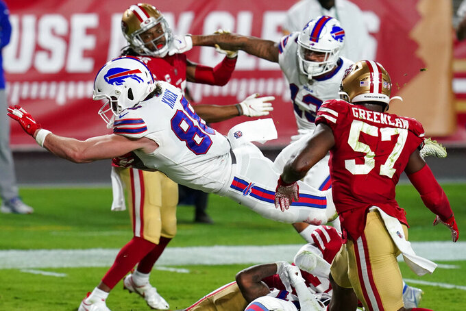Buffalo Bills tight end Dawson Knox (88) leaps into the end zone for a touchdown against the San Francisco 49ers during the first half of an NFL football game, Monday, Dec. 7, 2020, in Glendale, Ariz. (AP Photo/Ross D. Franklin)