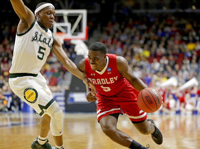Bradley's Darrell Brown (5) tries to get around Michigan State's Cassius Winston, left, during the first half of a first round men's college basketball game in the NCAA Tournament in Des Moines, Iowa, Thursday, March 21, 2019. (AP Photo/Nati Harnik)