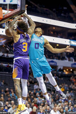 Phoenix Suns forward Kelly Oubre Jr. (3) dunks against Charlotte Hornets forward Miles Bridges (0) in the first half of an NBA basketball game in Charlotte, N.C., Monday, Dec. 2, 2019. (AP Photo/Nell Redmond)