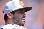 Cleveland Browns quarterback Baker Mayfield watches during the second half of an NFL preseason football game against the New York Giants, Sunday, Aug. 22, 2021, in Cleveland. (AP Photo/David Richard)